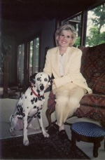 Laura Hart Burdick, pictured with her dog.