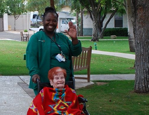 Resident and caregiver at Huger Mercy