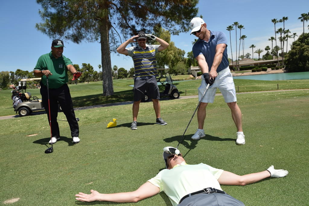 Golfers joking around