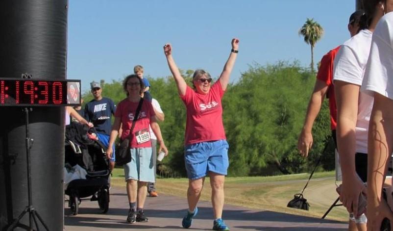 walker crossing finish line