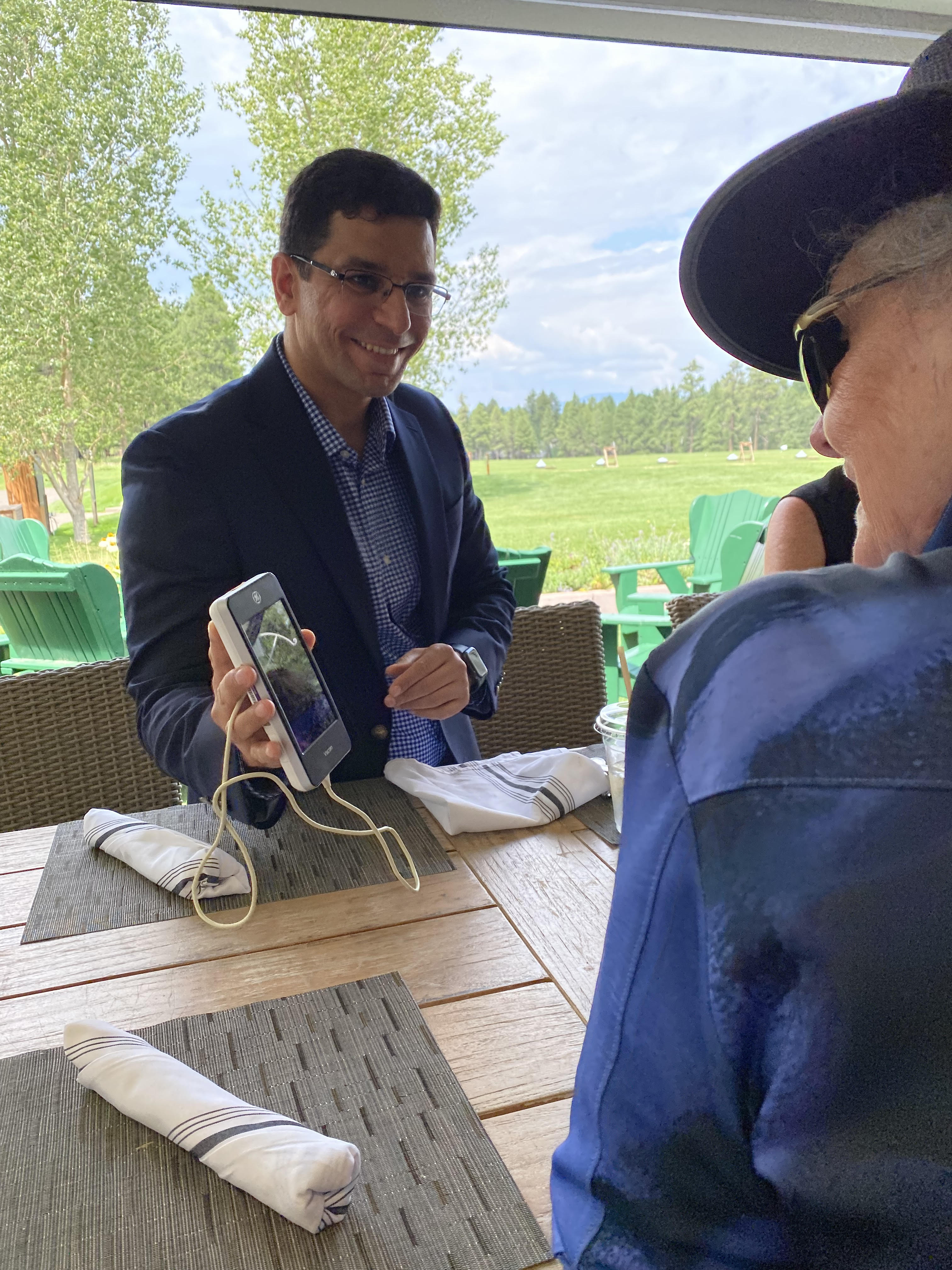 Dr. Saeed showing the POCUS device