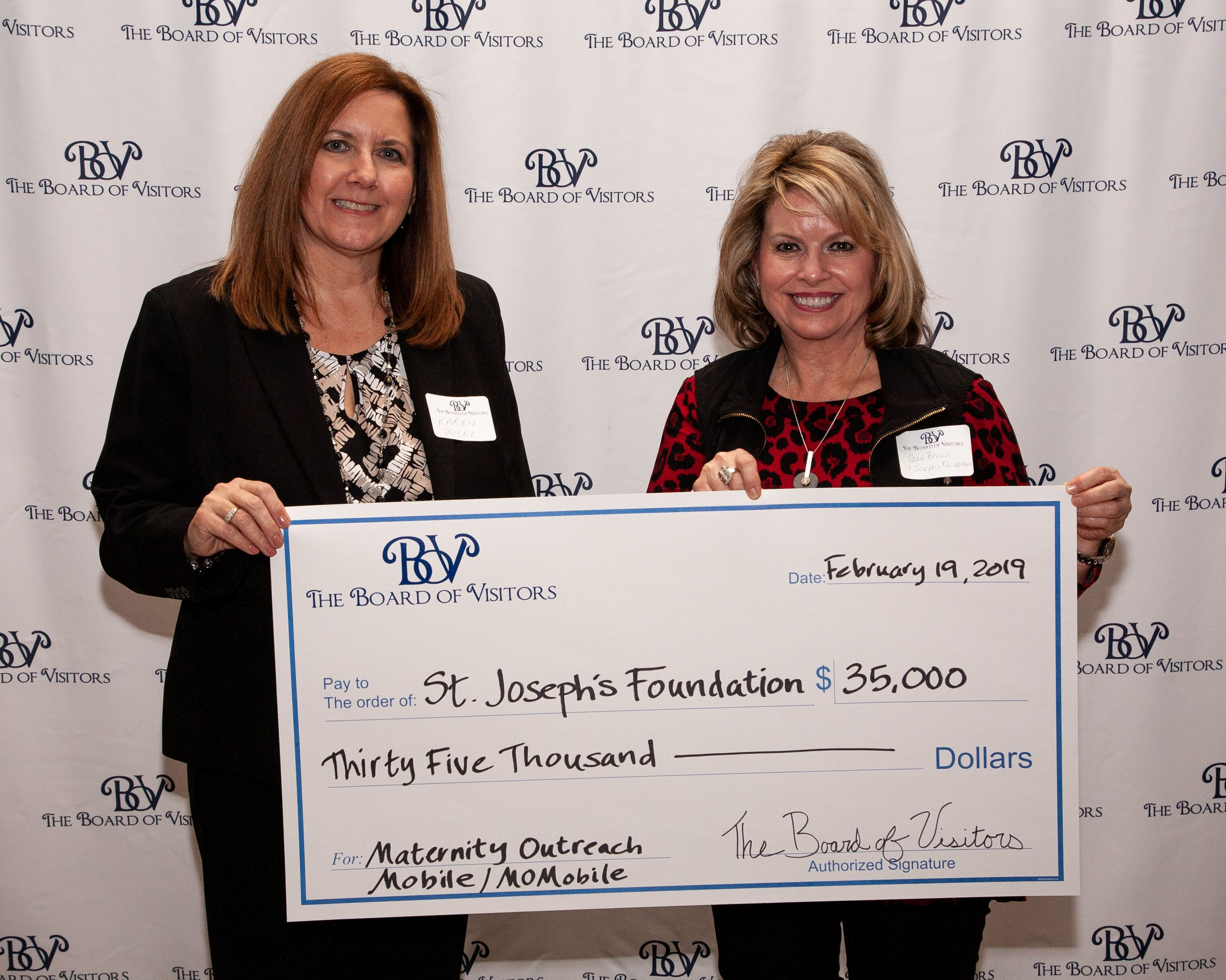 Karen Bisko and Gail Brown accept check