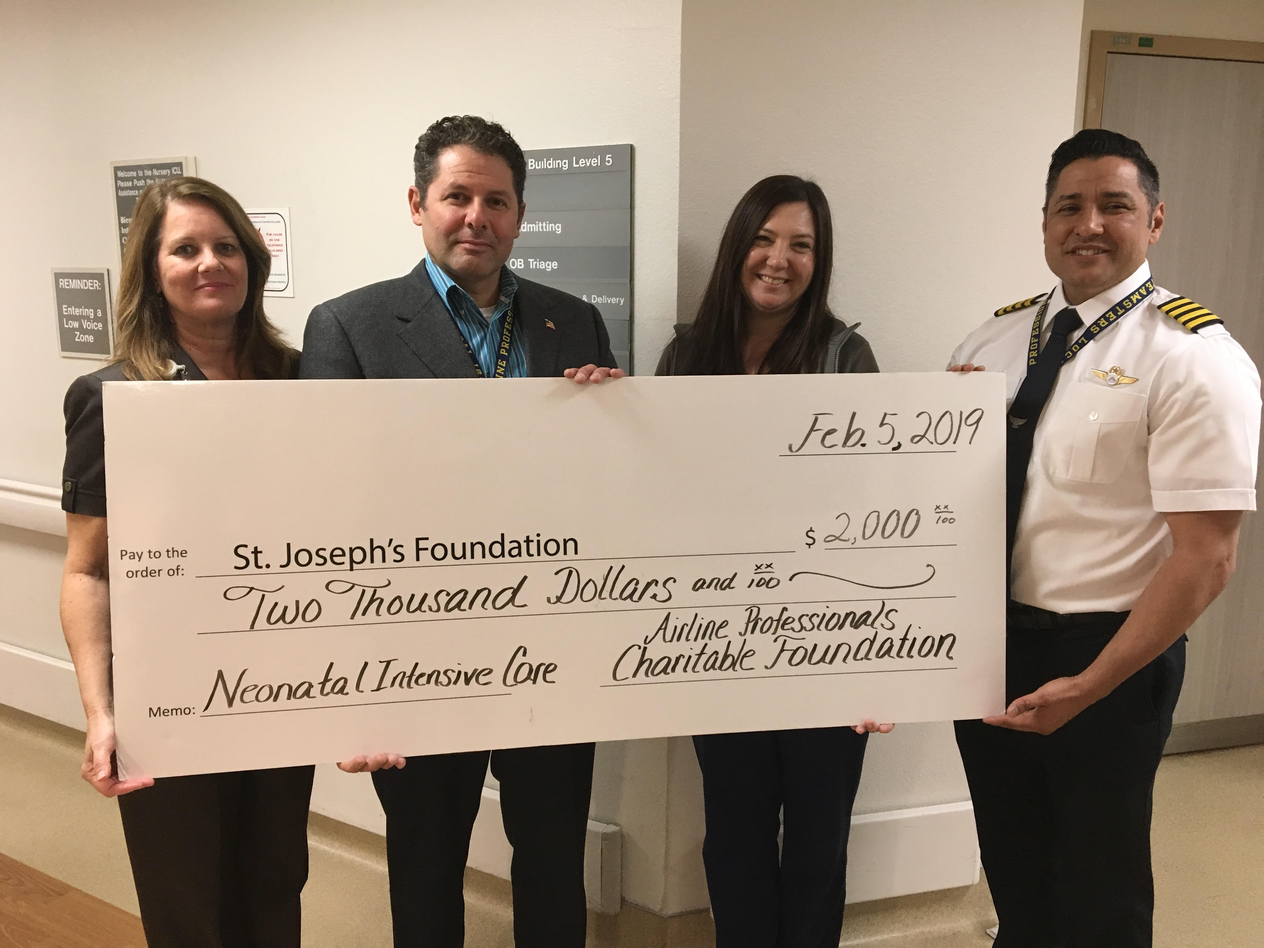 Pilots donate check to NICU nurse
