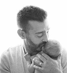 Mike Reuscher with infant son