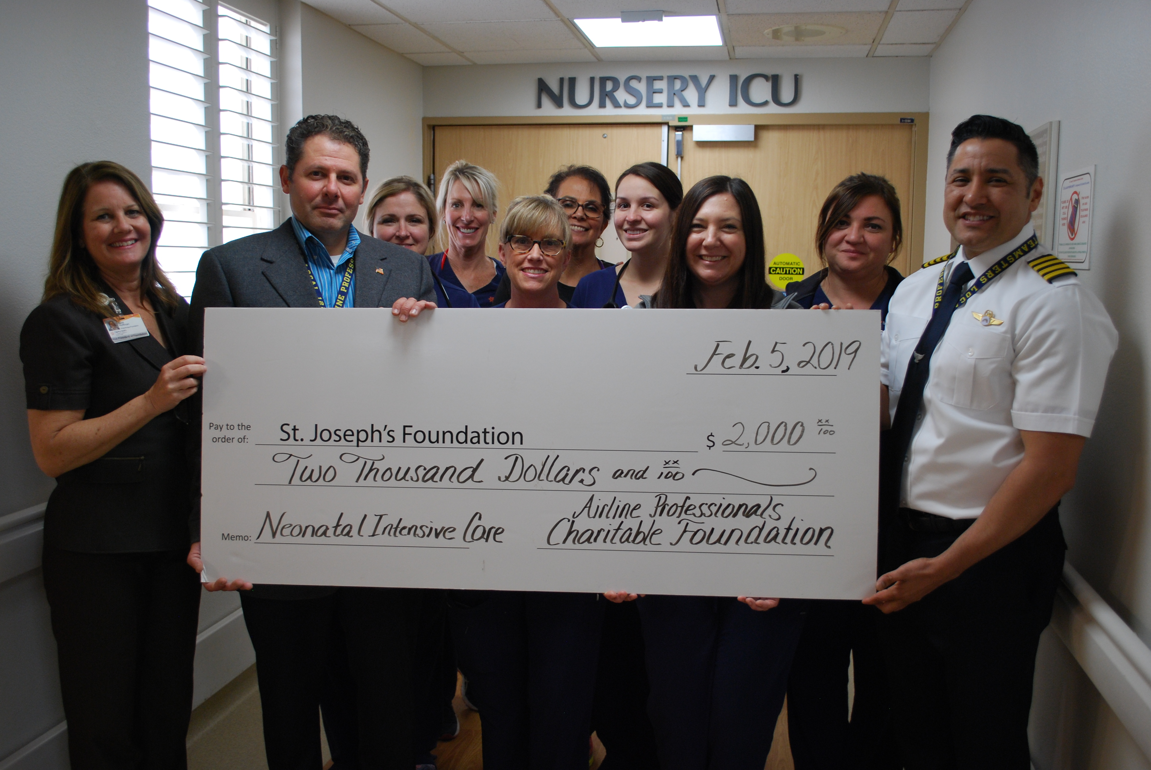 NICU nurses gather for check presentation