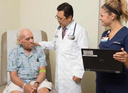 Dr. Wang counsels patient Scott Luton at St. Joseph's cancer center